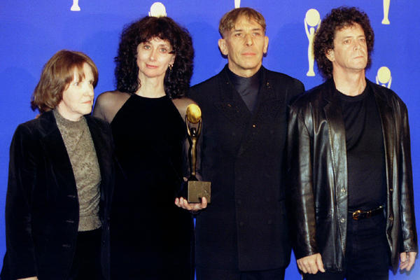 Maureen Tucker, Martha Morrison (wife of Sterling Morrison), John Cale and Lou Reed pose for photographers shortly after The Velvet Underground was inducted into the Rock and Roll Hall of Fame, Jan. 17, 1995.