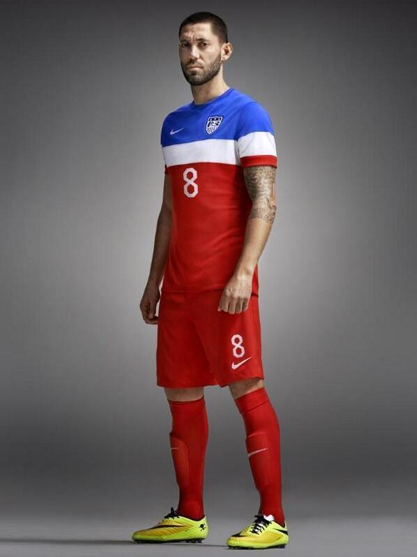 U.S. men's national team captain models the new World Cup uniform. The kit, unveiled by Nike Tuesday, uses wide bands of color instead of stars or stripes.
