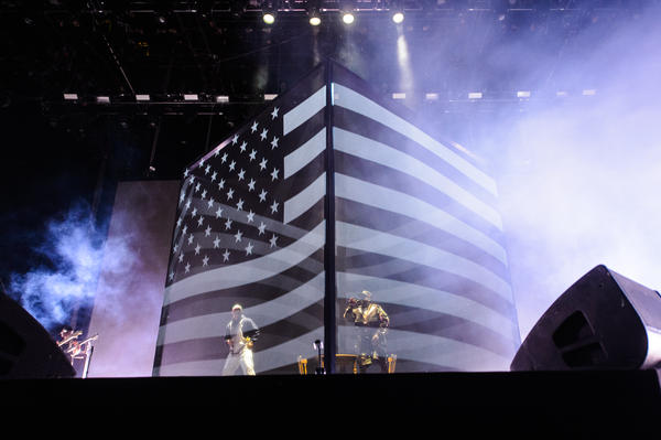 """The two rappers first appeared inside a mesh cube and were greeted by enormous cheers while they played the 2000 hit """"B.O.B."""""""