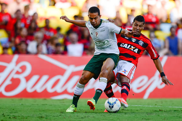 A player from the Brazilian team Palmeiras (left) battles with an opponent from Flamengo in Rio de Janeiro on May 4. Top teams like Palmeiras now recruit and train some young players before they reach their teens.