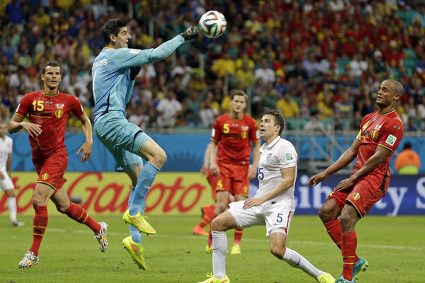 Belgium's goalkeeper, Thibaut Courtois, clears the ball over United States' Matt Besler during the match.
