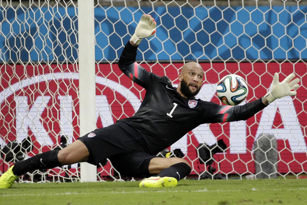 United States' goalkeeper Tim Howard stops a shot by Belgium. <br /><br />
