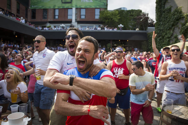 U.S. fans cheer while watching the match at Studio Square in the Queens, N.Y. The last time the U.S. reached the quarterfinals was in 2002.