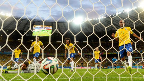 Brazilian goalkeeper Julio Cesar concedes a goal as his teammates look on during their 7-1 loss to Germany on Tuesday at the Mineirao Stadium in Belo Horizonte, Brazil.