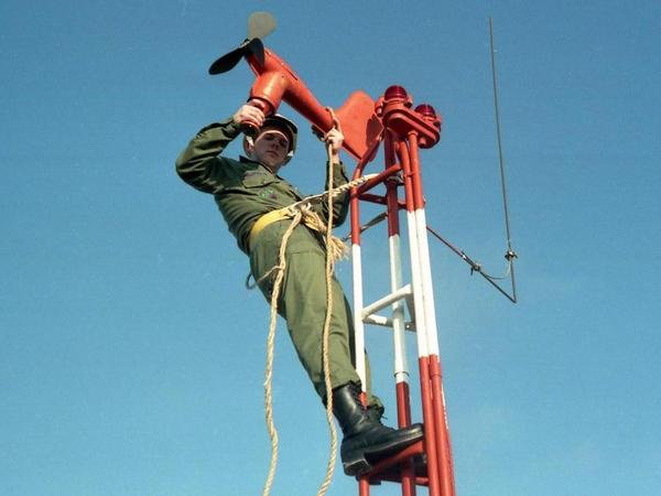 Lynn Eldredge started his working life in the Air Force in 1985. Here, he's installing a wind speed and direction transmitter.