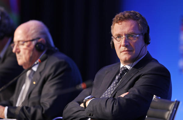 """FIFA Secretary-General Jérôme Valcke (right) and FIFA President Joseph """"Sepp"""" Blatter attend a news conference in 2014."""