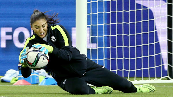 U.S. goalie Hope Solo stops a shot during training Tuesday at Olympic Stadium in Montreal.