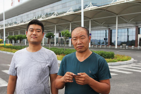 Wu Youfu (at left) and his uncle, Wu Dexi, a farmer, took Youfu's grandmother to visit Luliang's airport, a popular attraction for curious local farmers. It was conceived when this coal city was booming. Now the economy is in recession.