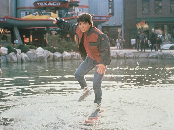 In <em>Back to the Future Part II,</em> Marty McFly (Michael J. Fox) slips on his Nike sneakers and rides a Mattel hoverboard in front of a Texaco gas station.