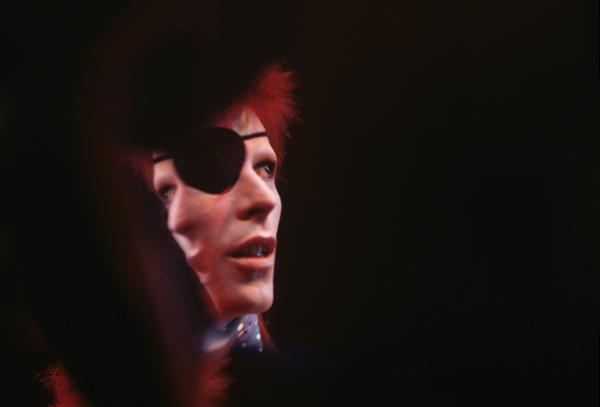 """David Bowie in 1974, on the set of the Dutch TV show <em>TopPop,</em> where he performed """"Rebel Rebel,"""" from the album <em>Diamond Dogs</em>."""