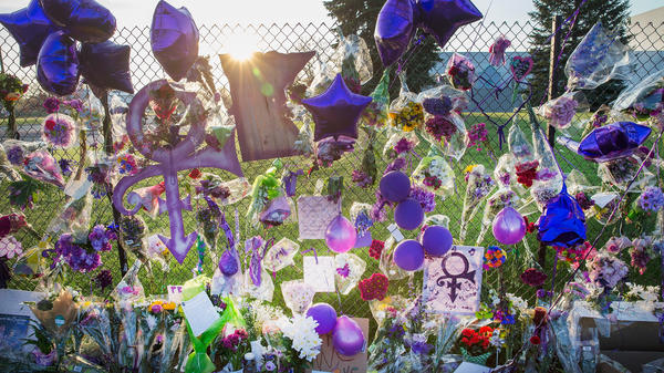 Fans leave mementos on the fence surrounding Paisley Park, Prince's home and studio in Chanhassen, Minn.