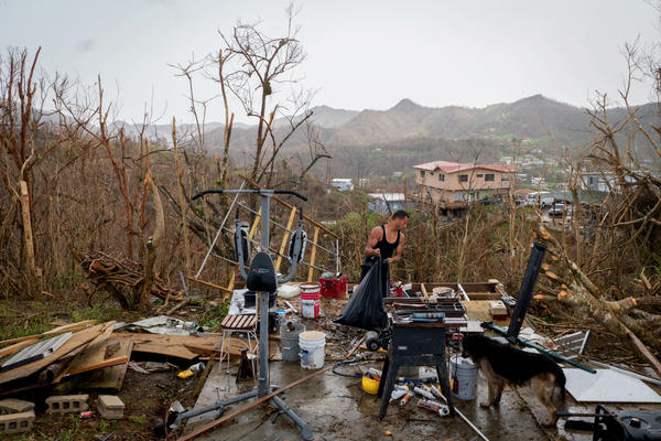 Juan Pablo Santos cleans up the debris from his shed near Aibonito, Puerto Rico, after it was destroyed by Hurricane Maria.