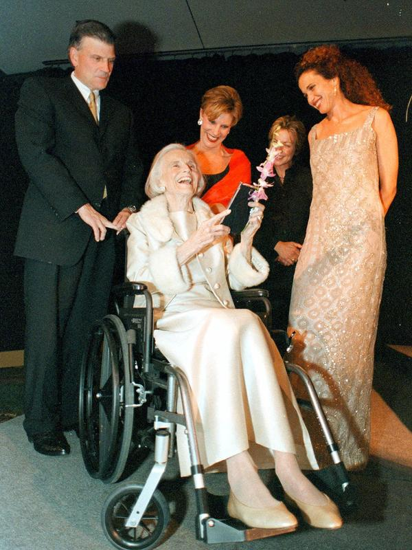 Ruth Bell Graham, seated, laughs as her son, the Rev. Franklin Graham (from left), daughter Gigi Graham Tchvidijian, novelist Patricia Cornwell and actress Andie MacDowell celebrate Graham's 80th birthday in Asheville, N.C., on May 30, 2000.