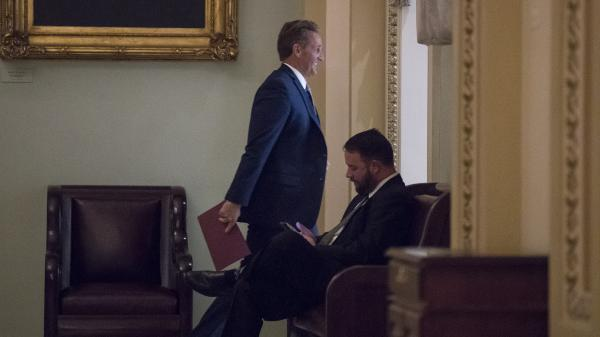 "Sen. Jeff Flake, R-Ariz., arrives for a Republican luncheon with President Donald Trump on Oct. 24. Hours later he went to the Senate floor to announce his retirement and denounce ""flagrant disregard of truth and decency"" in American politics."