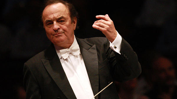 Charles Dutoit, leading the Royal Philharmonic Orchestra in 2012. Following sexual assault allegations, the conductor has stepped down immediately as the orchestra's artistic director and principal conductor.