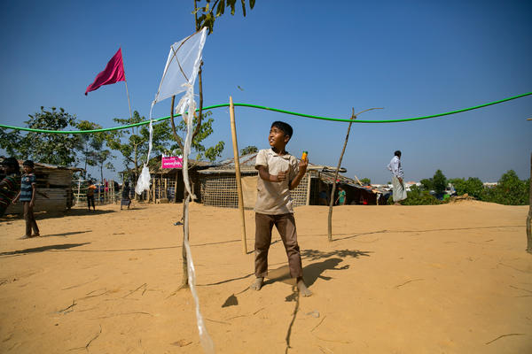 Khamal uses discarded pieces of bamboo and plastic to make his kites. Once the toy is in the air, he says he can feel through the string if it's a success or not. If it's bad, he immediately throws it away.