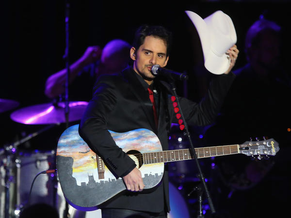 """Brad Paisley performs at an inaugural ball for Barack Obama in January 2013. A few months later, Paisley's song """"Accidental Racist"""" would make the country singer the focus of ridicule and satire."""