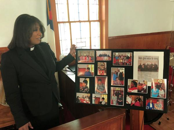The Rev. Shirley Heermance of St. Mark's AME Church in Topeka looks over an array of photos of Linda Brown. Funeral services for Brown were held Thursday in Topeka.