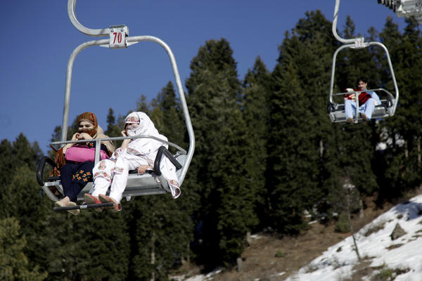 Women ride the chairlift at a new ski resort.