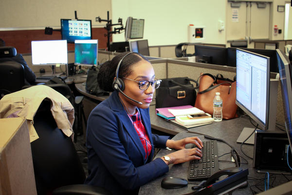 "Ogechi Ukachu, one of the registered nurses recently hired to help staff D.C.'s ""Right Care Right Now"" program, takes a training call at the city's 911 call center."