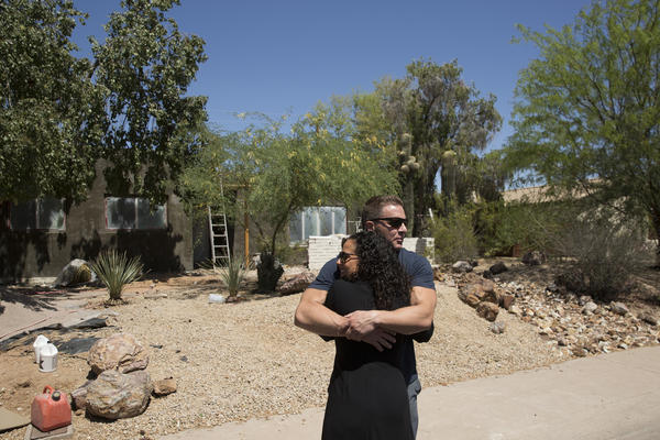 Brad Pickett greets Lauren Rosin as she arrives at one of their project properties. Unlike a decade ago, flippers have to add real value to their properties to make a profit.