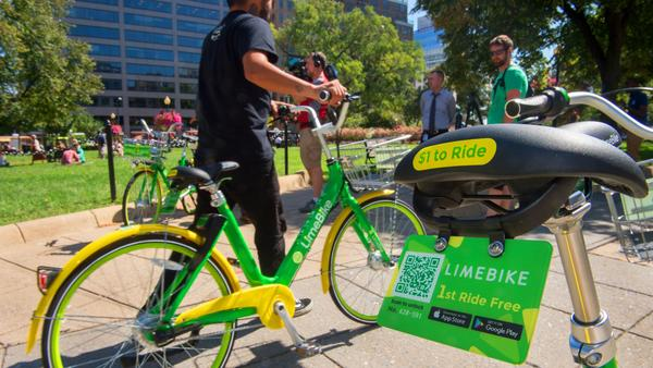 A man rides a LimeBike in Washington, DC.