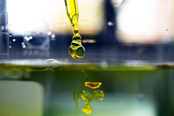 A sample of cannabidiol (CBD) oil is dropped into water. Supplements containing the marijuana extract are popular and widely sold as remedies for a variety of ailments and aches. But scientific evidence that they work hasn't yet caught up for most applications, researchers say.