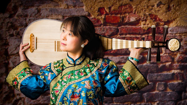 Wu Man hopes her use of the pipa will help teach the world more about Chinese culture.
