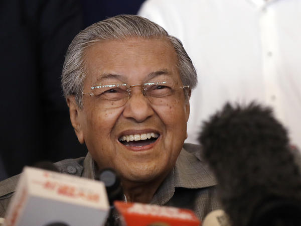 Mahathir Mohamad reacts as he speaks during a news conference in Kuala Lumpur, Malaysia, on Thursday, after his surprise victory.