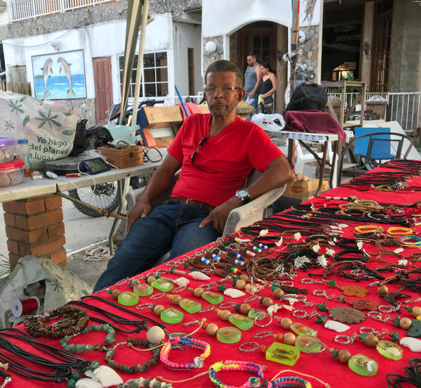 Harold James Tatum was deported to Honduras 18 years ago. He says he's never really gotten used to it — or found steady work. He now sells jewelry by the beach but says he doesn't make enough to live on.
