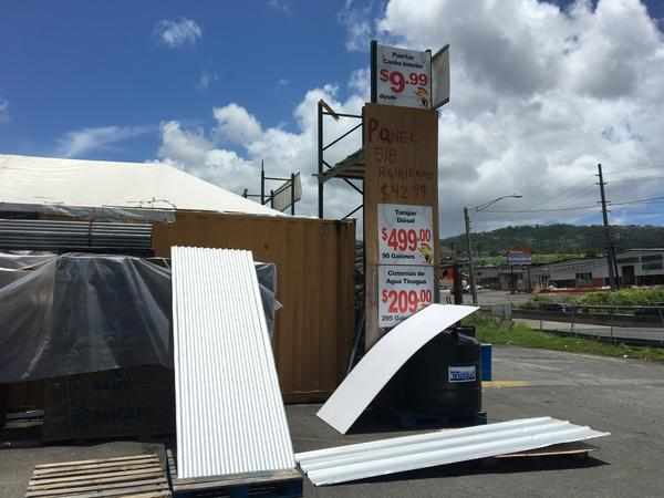 Javier Solis can't keep metal roofing panels in stock at his roadside hardware shop on the outskirts of San Juan.