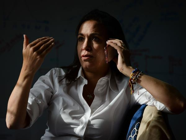 Venezuelan opposition politician María Corina Machado speaks on her mobile phone before an interview with the AFP in Caracas in August 2017.