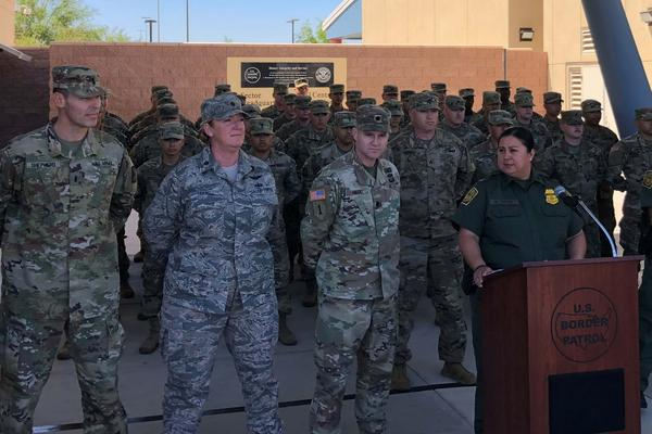 Members of the Cal. National Guard stand silently as the backdrop for a news conference in El Centro, Cal. by the local head of Customs and Border Protection, Gloria Chavez.