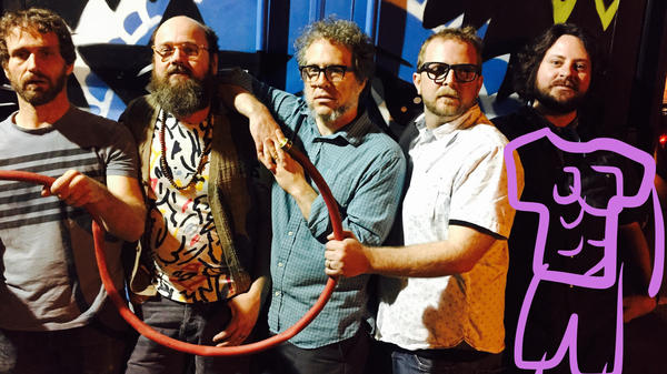 Air-Sea Dolphin is the new band from The Apples in Stereo frontman Robert Schneider (left of center) featuring the creators of <em>Homestar Runner</em>.