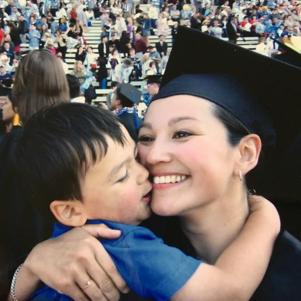 Rene Schimmel celebrates her master's degree in education with Sam. She became a teacher at the public elementary school that he would also attend.