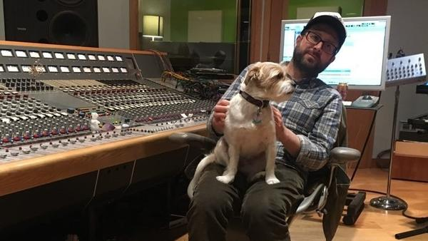 Producer and engineer Mike Mogis with a canine companion.