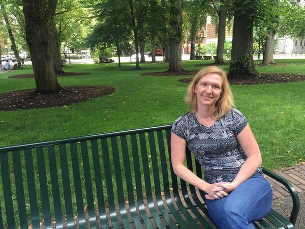 <p>Sharon Raymor sits on a bench on the South Park Blocks, not far from where she currently works for the City of Portland. She spent more than four years in Facilities and Asset Management at Portland Public Schools.</p>