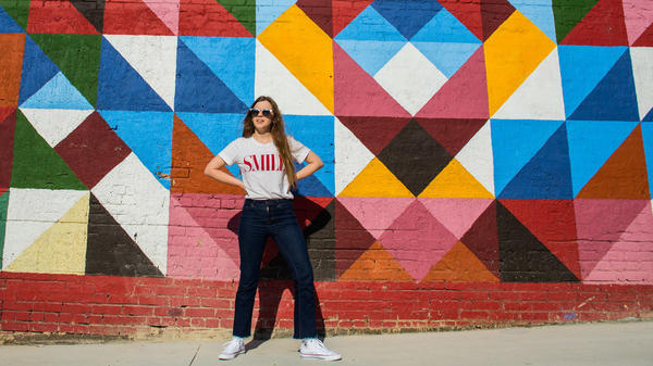Jade Bird in front of a mural in the entertainment district of Deep Ellum, Dallas, Texas.
