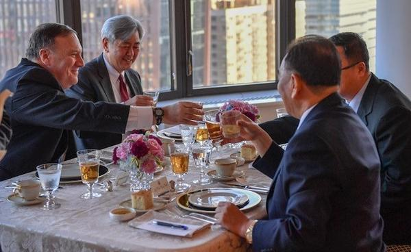 Secretary of State Mike Pompeo, the former CIA director, and CIA official Andrew Kim, the pair on the left, have dinner with North Korea's Kim Yong Chol, a former intelligence chief, in New York on Wednesday. Current and former spy chiefs are playing an unusually prominent role in arranging a proposed summit between President Trump and North Korean leader Kim Jong Un.