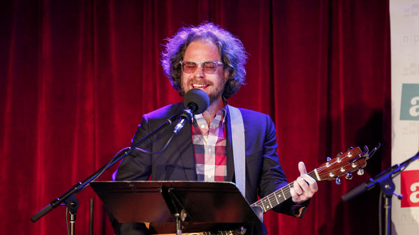House musician Jonathan Coulton performs a music parody game on Ask Me Another at the Bell House in Brooklyn, New York.