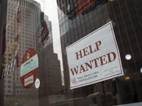 "A ""help wanted"" sign hangs on a window of a restaurant in New York City. The U.S. economy gained a stronger-than-expected 223,000 jobs last month and the unemployment rate edged down to an 18-year low."