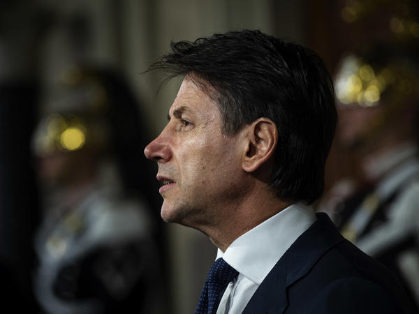 Law professor Giuseppe Conte, Italy's new prime minister designate, speaks to the media to present his ministers list after being appointed by Italian President Sergio Mattarella on Thursday in Rome, Italy.
