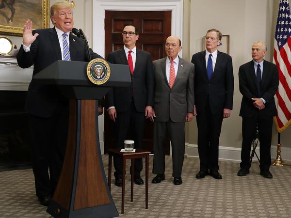 President Trump delivers remarks before signing tariff proclamations on steel and aluminum imports at the White House on March 8. Treasury Secretary Steven Mnuchin (second from left), Commerce Secretary Wilbur Ross, U.S. Trade Representative Robert Lighthizer and White House National Trade Council Director Peter Navarro look on.