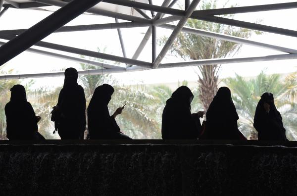Saudi women wait for their drivers outside a hotel in the Saudi capital Riyadh.