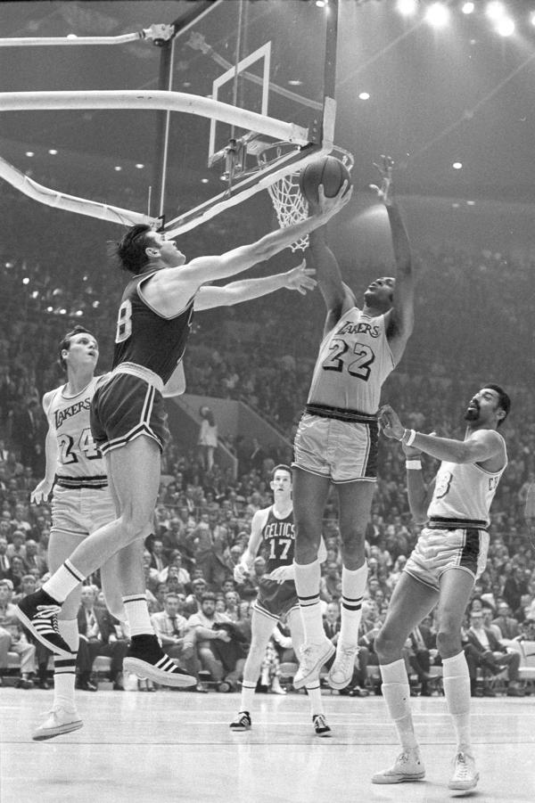 Elgin Baylor (right) of the LA Lakers blocks a reverse lay up attempt by Boston Celtics' Bailey Howell in Los Angeles on May 5, 1969.
