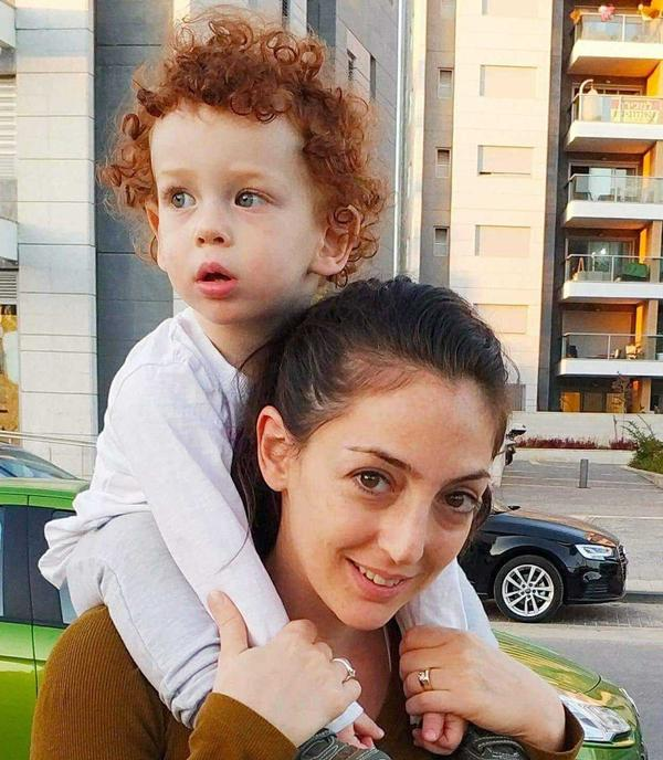 Dana Levy, with her 2-year-old son. She met Mohammed Saqar met when they were teenagers.