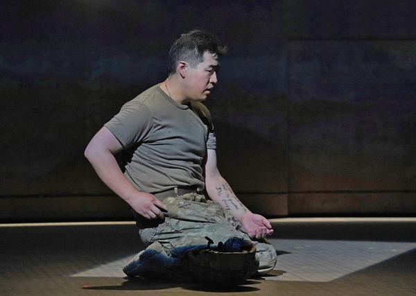 "Andrew Stenson as Private Danny Chen, in the new opera ""An American Soldier."""