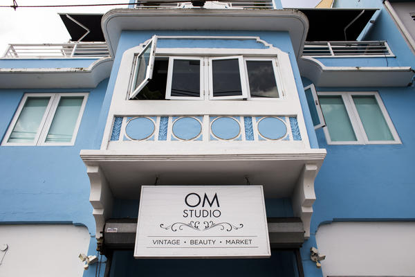 "Om's salon specializes in curly, natural hair. Since the storm, Om says many people are wearing their hair natural because they couldn't blow dry their hair straight when the electricity was out. ""They didn't even know what their natural hair looked like,"" Om says."