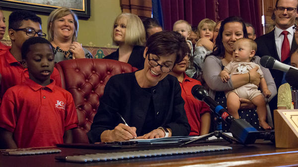 Governor Kim Reynolds signs SF-359, one of the most restrictive abortion bills in the U.S. It prohibits an abortion after a fetal heartbeat can be detected. A district judge has temporarily blocked the law.