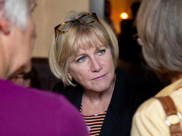 Democratic gubernatorial candidate Cathy Glasson campaigns one week before the primary election in a Des Moines restaurant. She says she thinks in order to win against Republican Gov. Kim Reynolds, she and her fellow candidates need to run far to the left.